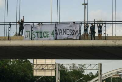 Members of #TeamVanessa and FIEL Houston gather demanding justice for Army Spc. Vanessa Guillen on the Dunlavy Street bridge that goes over the Southwest Freeway in Houston on Wednesday, July 8, 2020. (Mark Mulligan/Houston Chronicle via AP)
