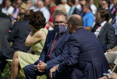 Andrew Wheeler, administrator of the Environmental Protection Agency, wears a mask as he arrives for an event on regulatory reform on the South Lawn of the White House, Thursday, July 16, 2020, in Washington. (AP Photo/Evan Vucci)
