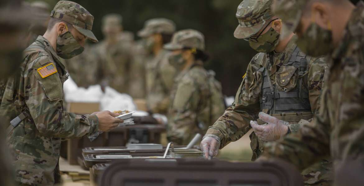 Soldiers in initial military training at Fort Jackson, S. C., line up to eat, May 11, 2020. (Victoria Evans)