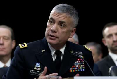 FILE - In this Jan. 29, 2019, file photo National Security Agency Director Gen. Paul Nakasone testifies before the Senate Intelligence Committee on Capitol Hill in Washington. Nakasone, the commander of U.S. Cyber Command and the director of the National Security Agency, says in a piece being published Tuesday, Aug. 24, 2020, by the magazine Foreign Affairs that the military's cyber fighters are increasingly prepared to engage in combat with online adversaries rather than wait to repair networks after they've been penetrated. (AP Photo/Jose Luis Magana, File)