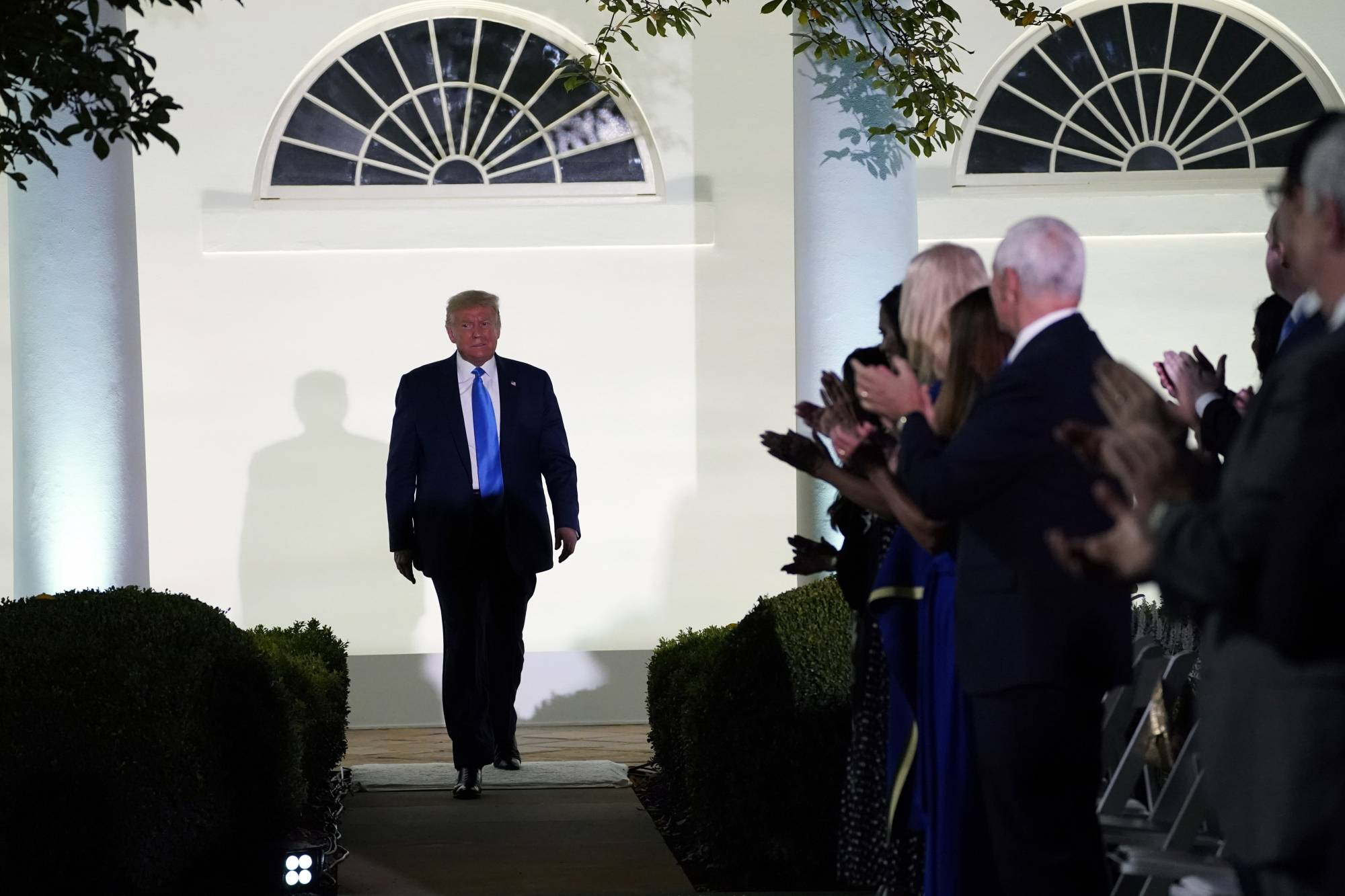 President Donald Trump arrives to listen to first lady Melania Trump speak during the 2020 Republican National Convention from the Rose Garden of the White House, Tuesday, Aug. 25, 2020, in Washington. (AP Photo/Evan Vucci)