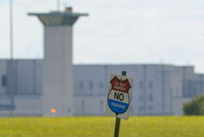FILE - In this Aug. 26, 2020, file photo, the federal prison complex in Terre Haute, Ind. The federal Bureau of Prisons will begin allowing inmates to have visitors again in October, months after visits were suspended at the 122 federal prisons across the U.S. The visitation plan is detailed in an internal memo issued Monday, Aug. 31, and obtained by The Associated Press. (AP Photo/Michael Conroy, File)