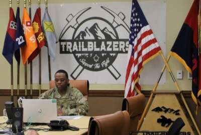 Command Sgt. Maj. Johnny Bryant, battalion sergeant major and president of the board, 4th Special Troops Battalion, 4th Sustainment Brigade, 4th Infantry Division listens to a Soldier's response during 4STB's virtual promotion board 29 April at the brigade headquarters building on Fort Carson, Colorado. The board members communicated with the Soldiers and their sponsors through video teleconference. (U.S. Army photo by Sgt. James Geelen, 4th Sustainment Brigade Public Affairs Office, 4th Infantry Division)