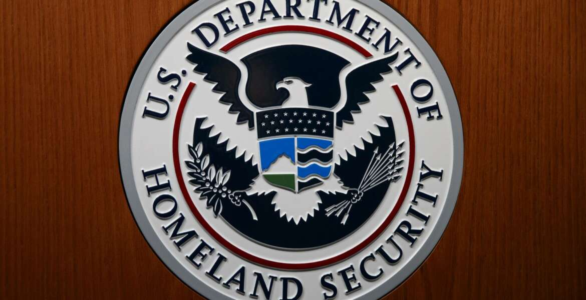 FILE - In this June 28, 2019, file photo the Department of Homeland Security (DHS) seal is seen during a news conference in Washington. An official at the Department of Homeland Security says he was pressured by agency leaders to suppress details in his intelligence reports that President Donald Trump might find objectionable, including intelligence on Russian interference in the election and the threat posed by white supremacists. (AP Photo/Carolyn Kaster, File)