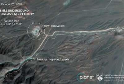 This Monday, Oct. 26, 2020, satellite image from Planet Labs Inc. that has been annotated by experts at the James Martin Center for Nonproliferation Studies at Middlebury Institute of International Studies shows construction at Iran's Natanz uranium-enrichment facility that experts believe may be a new, underground centrifuge assembly plant. Satellite photos show Iran has begun construction at its Natanz nuclear facility. That's after the head of the U.N.'s nuclear agency acknowledged Tehran is building an underground advanced centrifuge assembly plant after its last one exploded in a reported sabotage attack last summer. (Planet Labs Inc. via AP)