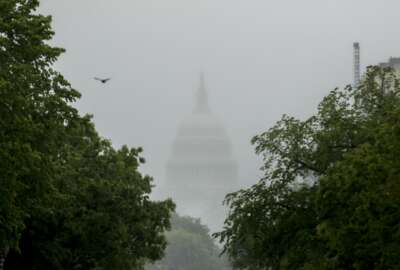 FILE - In this May 22, 2020, file photo the Dome of the U.S. Capitol Building is visible through heavy fog in Washington. New virus relief will have to wait until after the November election. Congress is past the point at which it can deliver more coronavirus aid soon, with differences between House Speaker Nancy Pelosi, Senate Republicans and President Donald Trump proving insurmountable. (AP Photo/Andrew Harnik, File)