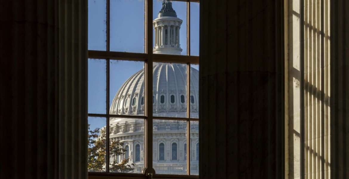 FILE - In this Nov. 10, 2020, file photo the morning sun illuminates the rotunda of the Russell Senate Office Building on Capitol Hill in Washington. After months of shadowboxing amid a tense and toxic campaign, Capitol Hill's main players are returning to Washington for one final, perhaps futile, attempt at deal making on a challenging menu of year-end business. (AP Photo/J. Scott Applewhite, File)