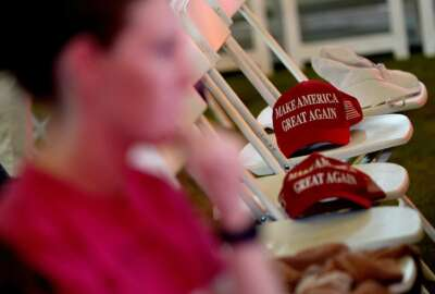 MAGA hats sit on empty seats during an election watch party, Tuesday, Nov. 3, 2020, in Chandler, Ariz. (AP Photo/Matt York)