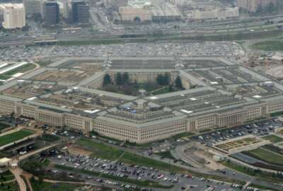 FILE - This March 27, 2008 file photo shows the Pentagon in Washington. In a first for the Pentagon's push to develop defenses against intercontinental-range ballistic missiles capable of striking the United States, a missile interceptor launched from a U.S. Navy ship at sea hit and destroyed a mock ICBM in flight on Tuesday, officials said. (AP Photo/Charles Dharapak, File)