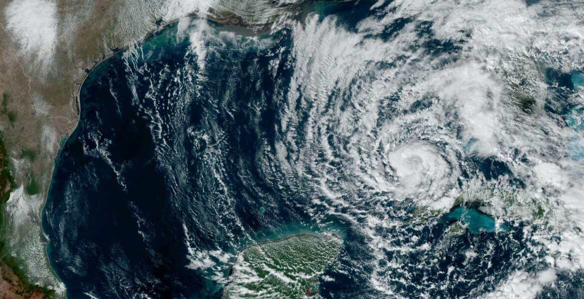 This Monday, Nov. 9, 2020 satellite image made available by NOAA shows Tropical Storm Eta in the Gulf of Mexico at 1:51 p.m. EST. At left is Texas and at bottom is Mexico's Yucatan peninsula. (NOAA via AP)