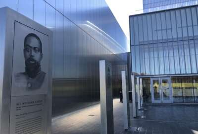 A marker commemorating the service of Sgt. William Carney, a former slave who served in the 54th Massachusetts Colored Infantry Regiment and became the first African American Medal of Honor recipient, is displayed outside the new National Museum of the United States Army on Tuesday, Nov. 10, 2020, in Fort Belvoir, Va. The museum opens Wednesday, Nov. 11 after more than a decade of that panning and fundraising. (AP Photo/Matthew Barakat)