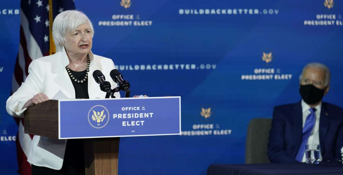 President-elect Joe Biden, right, listens as Janet Yellen, who Biden nominated to serve as Secretary of the Treasury, speaks at The Queen theater, Tuesday, Dec. 1, 2020, in Wilmington, Del. (AP Photo/Andrew Harnik)