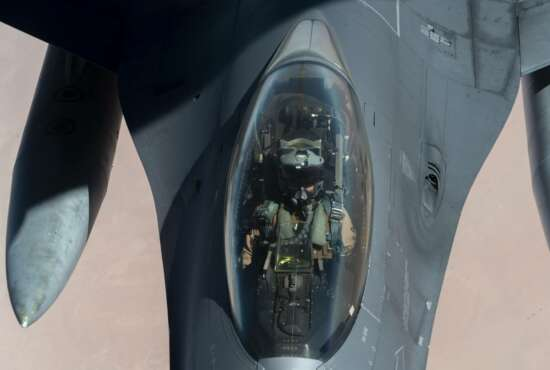 """U.S. Air Force F-16 Fighting Falcon is aerial refueled by a KC-135 """"Stratotanker"""" over the U.S. Central Command area of responsibility Wednesday, Dec. 30, 2020 as part of an escort mission in support of the B-52 """"Stratofortress"""" deployment. The United States flew strategic bombers over the Persian Gulf on Wednesday for the second time this month, a show of force meant to deter Iran from attacking American or allied targets in the Middle East. (Senior Airman Roslyn Ward/U.S. Air Force via AP)"""