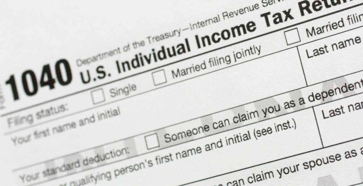 FILE - This July 24, 2018, file photo shows a portion of the 1040 U.S. Individual Income Tax Return form. It's the time of year to start thinking about taxes - what's ahead and what can be done now to manage. But the upcoming tax filing season is going to be trickier for many Americans due to rampant unemployment, working from home and general upheaval due to COVID-19. (AP Photo/Mark Lennihan, File)
