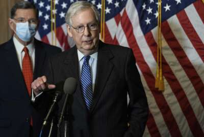 """FILE - In this Tuesday, Dec. 15, 2020, file photo, Senate Majority Leader Mitch McConnell, of Kentucky, speaks during a news conference with other Senate Republicans on Capitol Hill in Washington, while Sen. John Barrasso, R-Wyoming, listens at left. """"There will be another major rescue package for the American people,"""