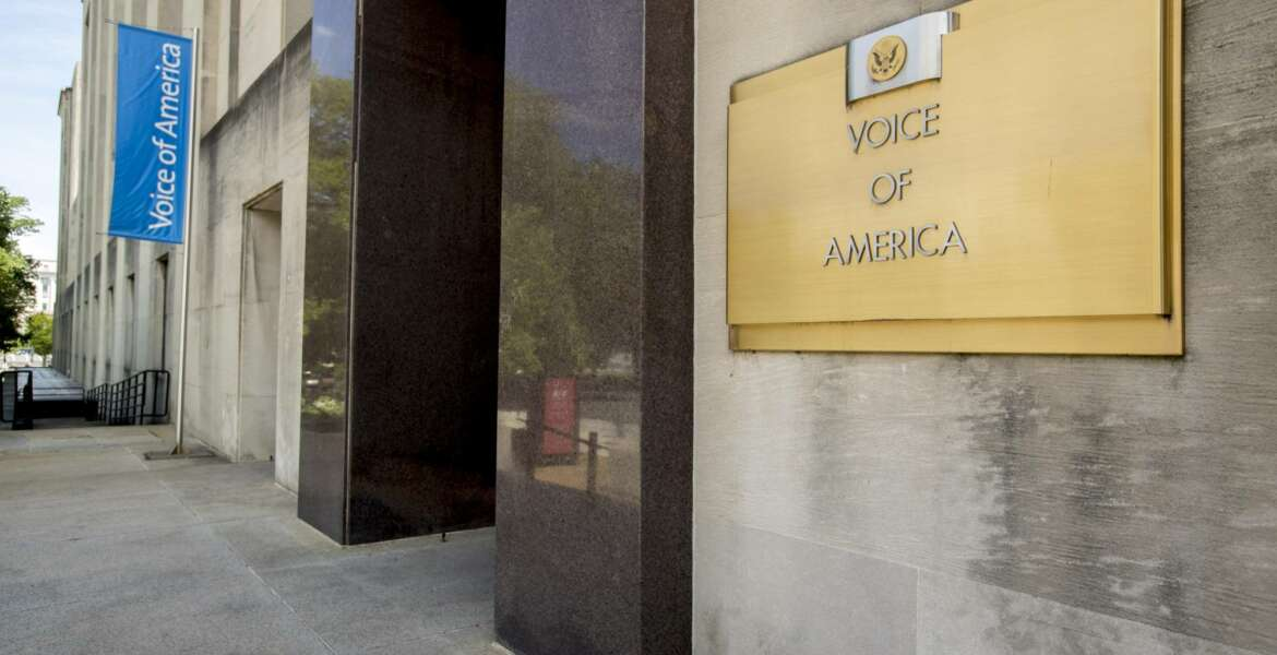 In this June 15, 2020, photo, The Voice of America building in Washington. Michael Pack, the head of U.S.-funded international broadcasting is pressing ahead with his shakeup of the Voice of America and sister outlets by naming new leaders for two of its main networks and moving to defund one of the federal government's top democracy promotion initiatives. (AP Photo/Andrew Harnik)