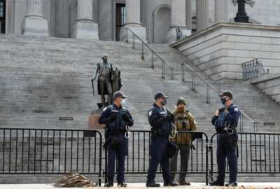 Law enforcement officers stand watch at South Carolina's Statehouse during an expected day of unrest across the country on Sunday, Jan. 17, 2021, in Columbia, S.C. (AP Photo/Meg Kinnard)