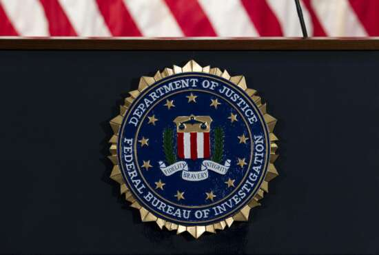 """FILE - In this June 14, 2018, file photo, the FBI seal is seen before a news conference at FBI headquarters in Washington. The U.S. government on Tuesday, Jan. 5, 2021, said a devastating hack of federal agencies is """"likely Russian in origin"""" and said the operation appeared to be an """"intelligence gathering"""" effort. The assessment was disclosed in a rare public statement from the FBI and other investigative agencies. (AP Photo/Jose Luis Magana, File)"""