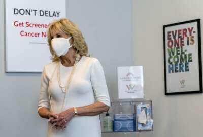 First lady Jill Biden smiles as she tours Whitman-Walker Health, Friday, Jan. 22, 2021, in Washington.(AP Photo/Jacquelyn Martin, Pool)