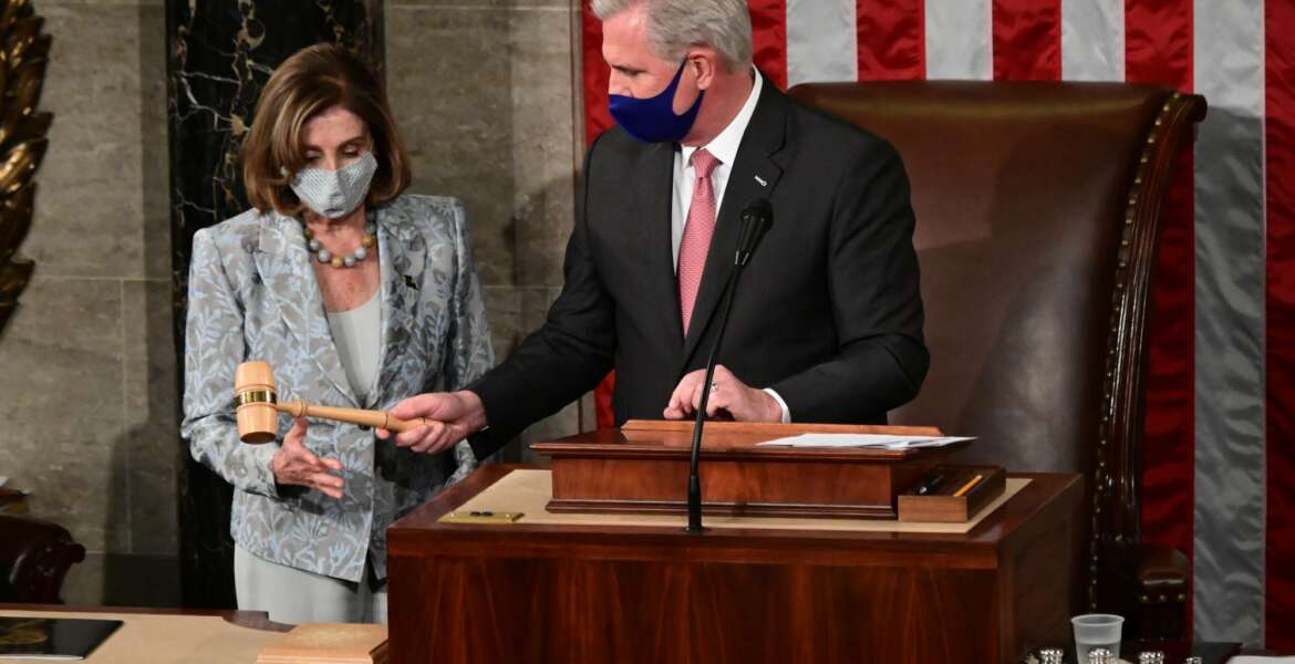 Speaker of the House Nancy Pelosi is handed the Speaker's gavel by House Minority Leader Kevin McCarthy, R-Calif., on the opening day of the 117th Congress on Capitol Hill in Washington, Sunday, Jan. 3, 2021. (Erin Scott/Pool via AP)