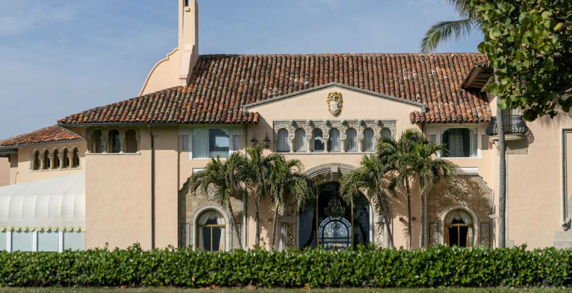 FILE - In this Monday, Jan. 18, 2021, file photo, is Mar-a-Lago in Palm Beach, Fla. Former President Donald Trump has been living at his Mar-a-Lago club since leaving office last week — a possible violation of a 1993 agreement he made with the Town of Palm Beach that limits stays to seven consecutive days. Town Manager Kirk Blouin said in a brief email Thursday, Jan. 28, that Palm Beach is examining its options and the matter might be discussed at the town council's February meeting.  (Greg Lovett/The Palm Beach Post via AP, File)