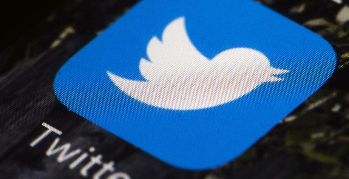 FILE - This April 26, 2017, file photo shows the Twitter app icon on a mobile phone in Philadelphia. Twitter is enlisting its users to help combat misinformation on its service by flagging and notating misleading and false tweets. The pilot program unveiled Monday, Jan. 25, 2021 called Birdwatch, allows a preselected group of users — for now, only in the U.S. — who sign up through Twitter. Those who want to sign up must have a U.S.-based phone carrier, verified email and phone number, and no recent Twitter rule violations. (AP Photo/Matt Rourke, File)