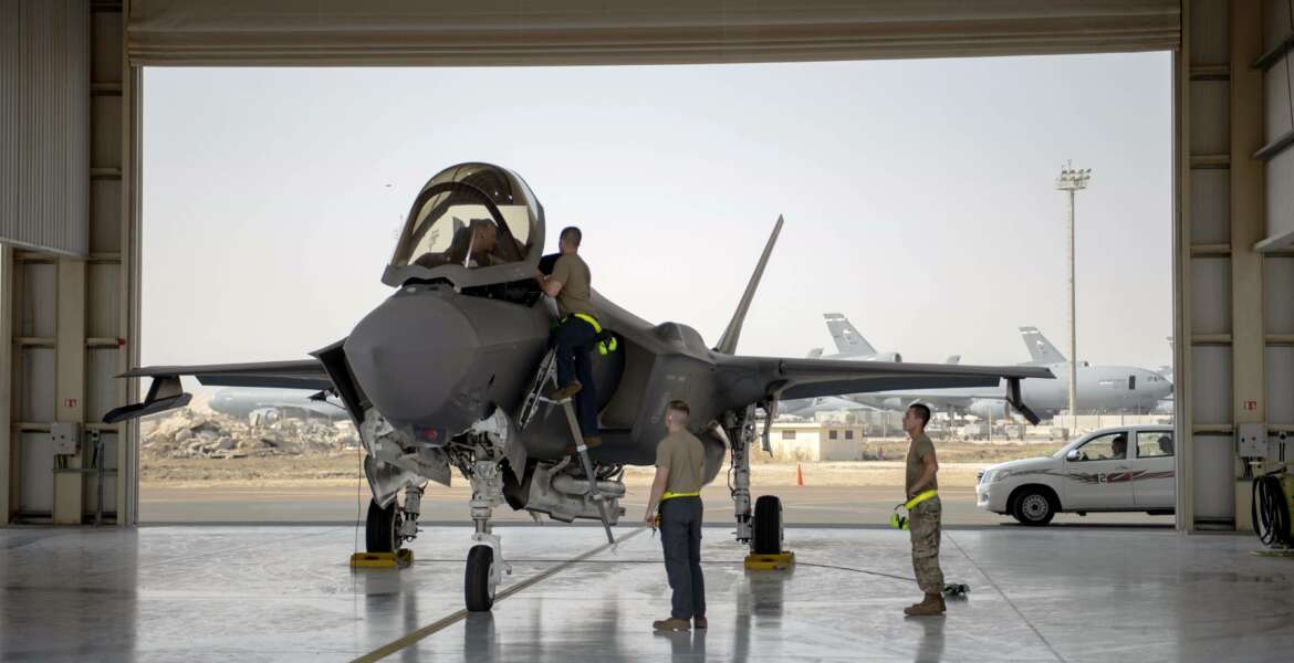 In this Aug. 5, 2019 photo released by the U.S. Air Force, an F-35 fighter jet pilot and crew prepare for a mission at Al-Dhafra Air Base in the United Arab Emirates. The Biden administration has put a temporary hold on several major foreign arms sales initiated by former President Donald Trump. Officials say that among the deals being paused is a massive $23 billion transfer of stealth F-35 fighters to the United Arab Emirates. (Staff Sgt. Chris Thornbury/U.S. Air Force via AP)