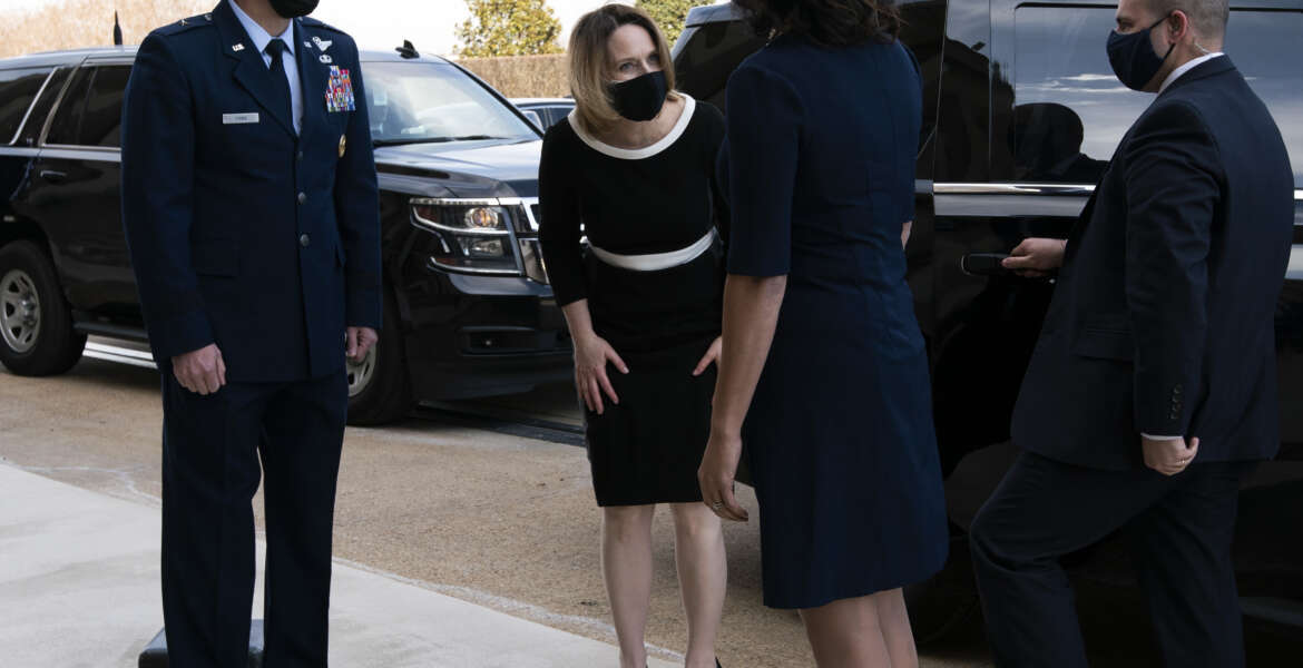 Deputy Secretary of Defense Kathleen Hicks, center, arrives at the Pentagon, Tuesday, Feb. 9, 2021, in Washington. (AP Photo/Jose Luis Magana)