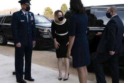 Deputy Secretary of Defense Kathleen Hicks, center, arrives at the Pentagon, Tuesday, Feb. 9, 2021, in Washington. (AP Photo/Jose Luis Magana)