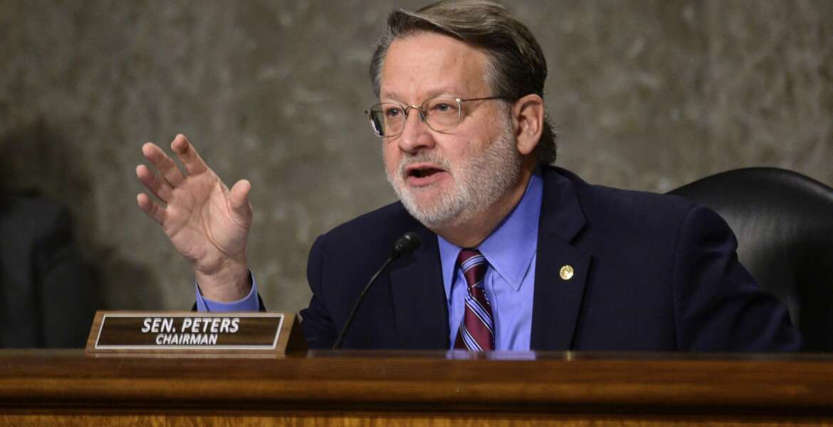 Chairman Sen. Gary Peters., D-Mich., speaks during a Senate Homeland Security and Governmental Affairs & Senate Rules and Administration joint hearing on Capitol Hill, Washington, Tuesday, Feb. 23, 2021, to examine the January 6th attack on the Capitol. (Erin Scott/The New York Times via AP, Pool)