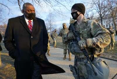 Secretary of Defense Lloyd Austin visits National Guard troops deployed at the U.S. Capitol and its perimeter, Friday, Jan. 29, 2021 on Capitol Hill in Washington. (AP Photo/Manuel Balce Ceneta, Pool)