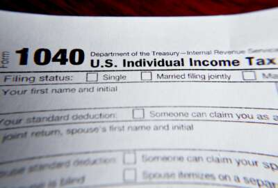 FILE - This Wednesday, Feb. 13, 2019 file photo shows part of a 1040 federal tax form printed from the Internal Revenue Service website, in Zelienople, Pa.  Tax filing season will start a bit later and look a bit different this year. That's because the pandemic that defined 2020 has seeped into tax time as well. If you worked from home, received a relief payment, took on some gig work or filed unemployment benefits _ or someone filed a fake claim in your name _ there are things you need to be aware of. Likewise if you normally receive certain tax credits. The IRS will begin accepting tax returns on Feb. 12, 2021.  (AP Photo/Keith Srakocic, File)