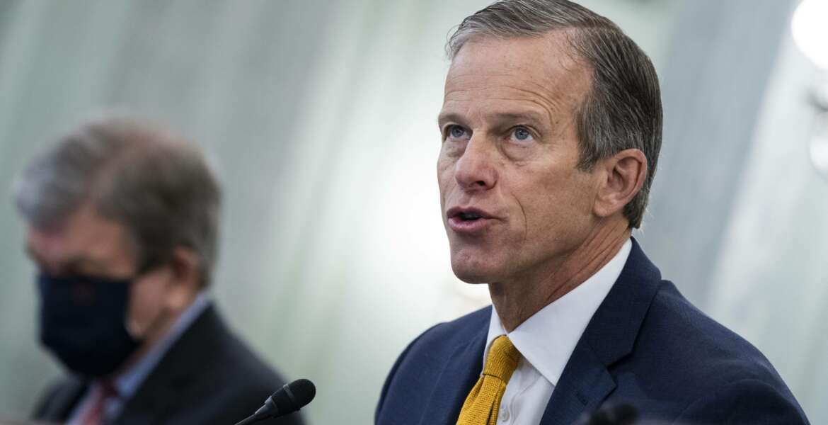 FILE - In this Jan. 26, 2021, file photo, Sen. John Thune, R-S.D., speaks on Capitol Hill in Washington. In an interview with The Associated Press, Sen. Thune, the chamber's No. 2 Republican, likened Trump's insults of Minority Leader Mitch McConnell to