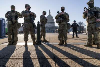 Members of the Michigan National Guard and the U.S. Capitol Police keep watch as heightened security remains in effect around the Capitol grounds since the Jan. 6 attacks by a mob of supporters of then-President Donald Trump, in Washington, Wednesday, March 3, 2021. The U.S. Capitol Police say they have intelligence showing there is a