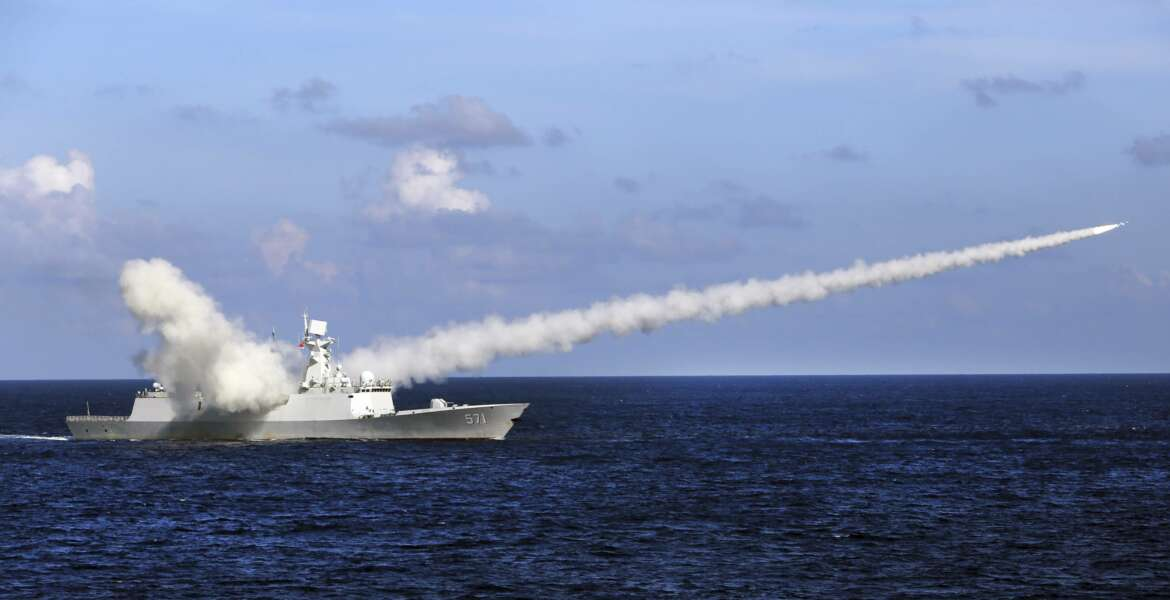FILE - In this July 8, 2016, file photo released by Xinhua News Agency, Chinese missile frigate Yuncheng launches an anti-ship missile during a military exercise in the waters near south China's Hainan Island and Paracel Islands. Ahead of the 2021 annual Congress meetings, China is continuing its military buildup and recently passed a law authorizing its coast guard to use force to remove foreign presences in what it considers Chinese waters and islands. (Zha Chunming/Xinhua via AP, File)