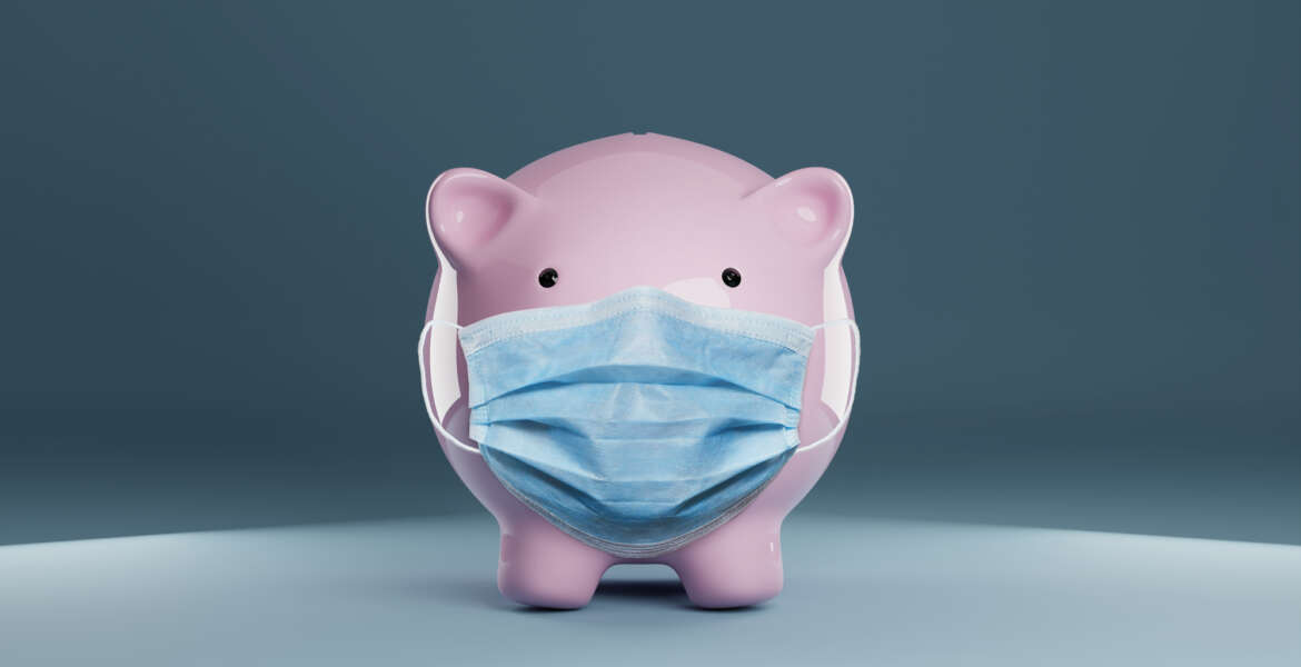 Piggy bank wearing a protective hygiene mask on blue background. Concept for saving, insurance, healthcare or financial economic crisis concept in time of coronavirus pandemic.