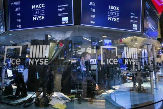 In this photo provided by the New York Stock Exchange, a trader works on the floor on Wednesday, March 3, 2021. Stocks were mostly lower in afternoon trading as another tick up in bond yields gave investors pause. (Courtney Crow/New York Stock Exchange via AP)