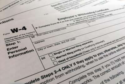 FILE - In this Feb. 5, 2020, file photo, a W-4 form is viewed in New York. The IRS will delay the traditional April 15 tax filing due date until May 17, 2021, to cope with added duties and provide Americans more flexibility. (AP Photo/Patrick Sison, File)