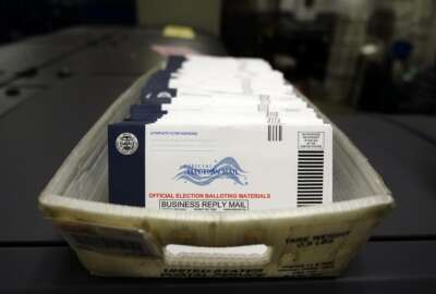 FILE - In this Oct. 23, 2020, file photo mail-in ballots for the 2020 General Election in the United States are seen before being sorted at the Chester County Voter Services office in West Chester, Pa. A new study finds the expansion of mail voting did not benefit Democrats or increase turnout. (AP Photo/Matt Slocum, File)