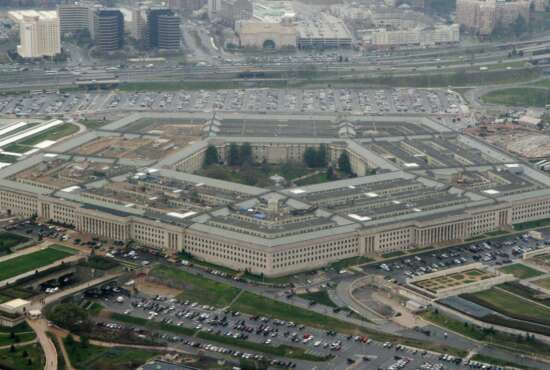 FILE - This March 27, 2008, file photo, shows the Pentagon in Washington. Defense officials say the Pentagon will sweep away Trump-era policies that largely banned transgender people from serving in the military and will issue new rules that broaden their access to medical care and gender transition. (AP Photo/Charles Dharapak, File)