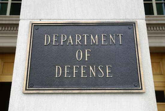 FILE - This April 19, 2019 file photo shows a sign for the Department of Defense at the Pentagon in Washington. The Biden administration's nominee for top Pentagon policy adviser was met with sharp criticism from Republicans on the Senate Armed Services Committee Thursday, including accusations that he has been too partisan to be confirmed for the job. Colin Kahl, who served as national security adviser to then-Vice President Joe Biden during the Obama administration, faced repeated questions on his previous support for the Iran nuclear deal and how he would approach that issue now. (AP Photo/Patrick Semansky)