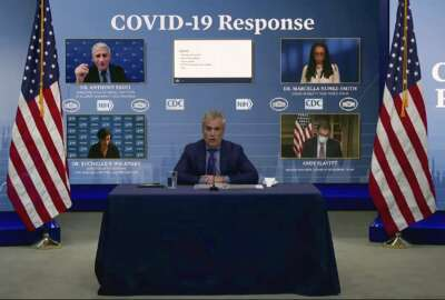 FILE - In this Jan. 27, 2021, file image from video, Jeff Zients, White House coronavirus response coordinator, speaks as Dr. Anthony Fauci, director of the National Institute of Allergy and Infectious Diseases and chief medical adviser to the president., Dr. Marcella Nunez-Smith, chair of the COVID-19 health equity task force, Dr. Rochelle Walensky, director of the Centers for Disease Control and Prevention, and Andy Slavitt, senior adviser to the White House COVID-19 Response Team,, appear on screen during a White House briefing on the Biden administration's response to the COVID-19 pandemic in Washington. (White House via AP, File)