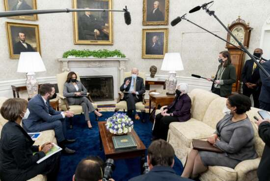 President Joe Biden, accompanied by from left, Council of Economic Advisers chairwoman Cecilia Rouse, National Economic Council director Brian Deese, Vice President Kamala Harris, Treasury Secretary Janet Yellen and Office of Management and Budget acting director Shalanda Young, speaks as he gets his weekly economic briefing in the Oval Office of the White House, Friday, April 9, 2021, in Washington. (AP Photo/Andrew Harnik)