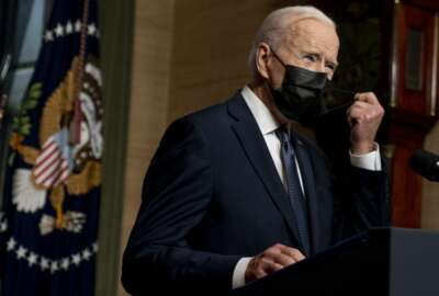 FILE - In this Wednesday, April 14, 2021, file photo, President Joe Biden removes his mask to speak at a news conference at the White House, in Washington. Ten liberal senators are urging Biden to back India and South Africa's appeal to the World Trade Organization to temporarily relax intellectual property rules so coronavirus vaccines can be manufactured by nations that are struggling to inoculate their population. (AP Photo/Andrew Harnik, Pool, File)
