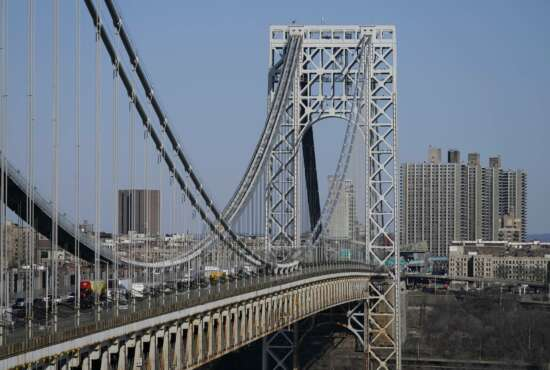 Traffic moves over the George Washington Bridge as seen from Fort Lee, N.J., Tuesday, April 6, 2021. President Joe Biden is setting about convincing America it needs his $2.3 trillion infrastructure plan, deputizing a five-member