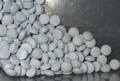FILE - This undated file photo provided by the U.S. Attorneys Office for Utah and introduced as evidence at a trial shows fentanyl-laced fake oxycodone pills collected during an investigation. Congress has voted to temporarily extend a sweeping tool that has helped federal agents crack down on drugs chemically similar to fentanyl. The Senate on Thursday, April 29, 2021, approved legislation extending until October an order that allows the federal government to classify so-called fentanyl analogues as Schedule I controlled substances. The drugs are generally foreign-made with a very close chemical makeup to the dangerous opioid. (U.S. Attorneys Office for Utah via AP, File)