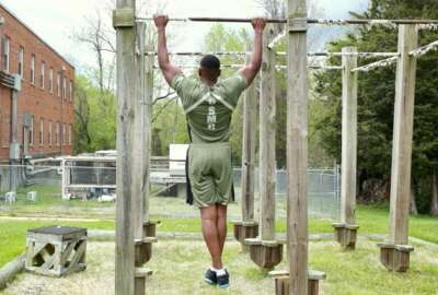 Capt. Donovan Holloway, an intelligence officer at Marine Corps Systems Command, demonstrates a prototype version of the new physical training uniform.