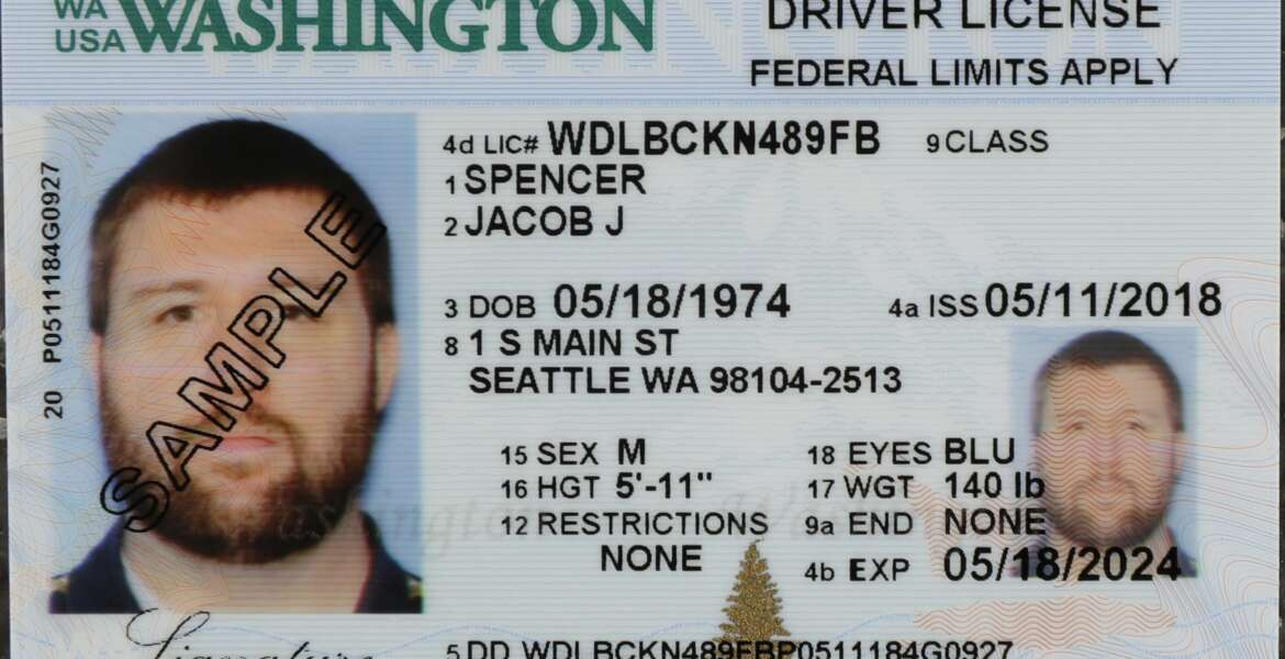 FILE - In this June 22, 2018, file photo a sample copy of a Washington drivers license is shown at the Washington state Dept. of Licensing office in Lacey, Wash. Americans will have more time because of the pandemic to get the Real ID that they will need to board a flight or enter federal facilities. The Department of Homeland Security on Tuesday, April 27, 2021, extended the Real ID deadline until May 3, 2023.  (AP Photo/Ted S. Warren, File)