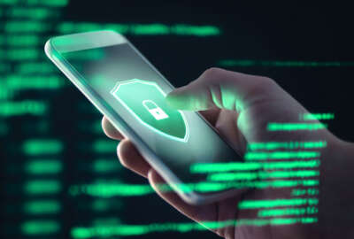 Mobile phone personal data and cyber security threat concept. Cellphone fraud. Smartphone hacked with illegal spyware, ransomware or trojan software. Hacker doing online scam. Antivirus error.