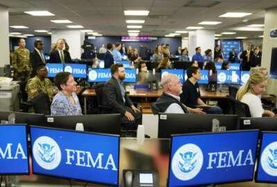 FEMA employees listen to President Joe Biden talk at FEMA headquarters, Monday, May 24, 2021, in Washington. (AP Photo/Evan Vucci)